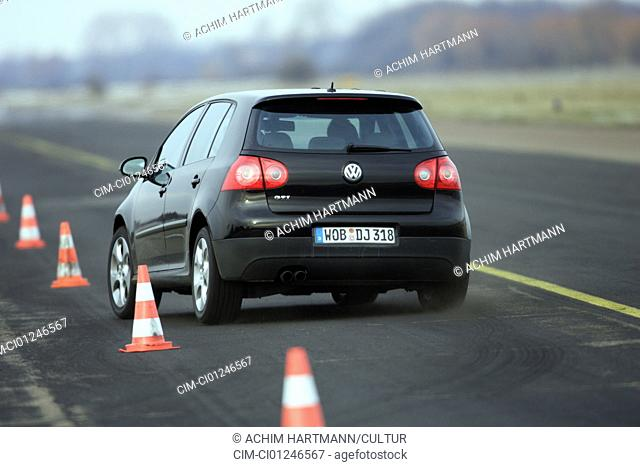 Car, VW Volkswagen Golf GTI, model year 2004-, Limousine, Lower middle-sized class, black, driving, diagonal from the back, rear view, test track, Pilonen