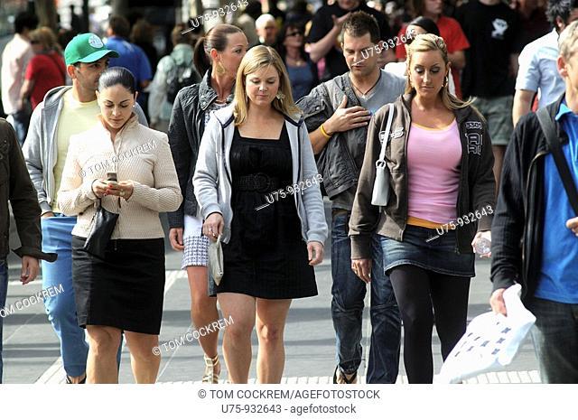 pedestrians in Swanston Street, Melbourne, Australia
