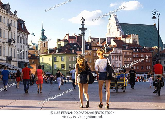 Beautiful young women walking at Castle Square. Warsaw, Poland