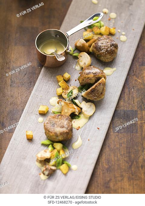 Small meat fritters with mushroom salad and potato cubes