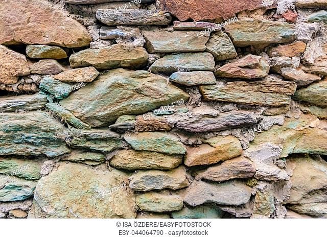View of old Rustic big rocks wall for background. Copy space for editing