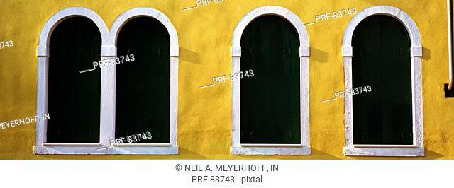 Windows in Yellow Wall Venice Italy
