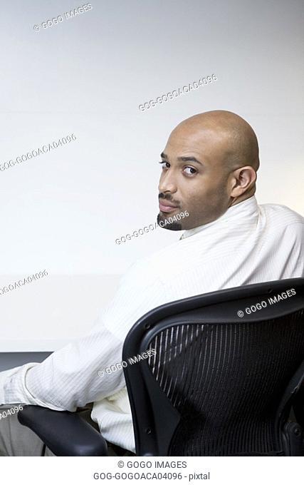 Businessman sitting at his desk