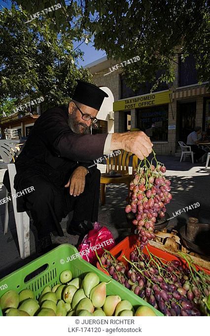 Monk, Priest selling fruit, Geroskipou, near Pafos, South Cyprus, Cyprus
