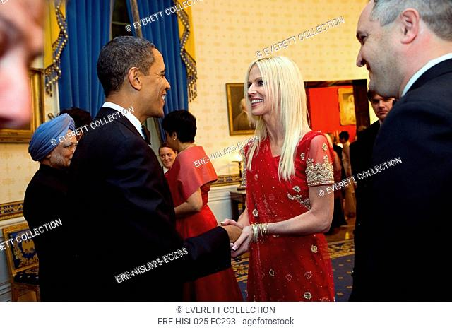 President Obama greets party crashers Michaele and Tareq Salahi in a receiving line in the Blue Room before the State Dinner with Prime Minister Manmohan Singh...