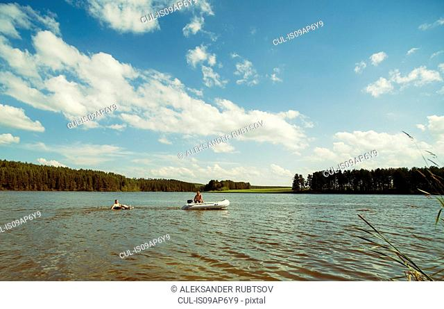 People in dinghy, Rezh River, Sverdlovsk Oblast, Russia
