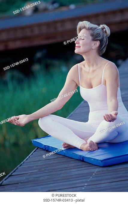 Mid adult woman meditating