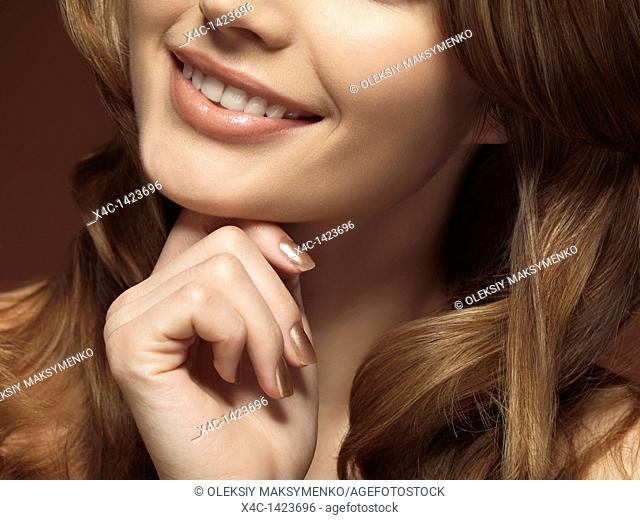Closeup portrait of a beautiful young smiling woman