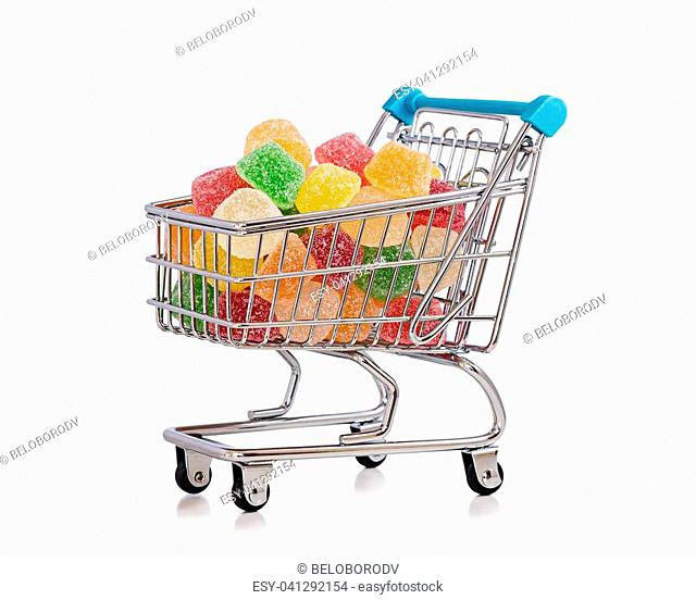 Miniature shopping trolley full of colored jelly candies