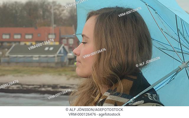 Woman with blue umbrella
