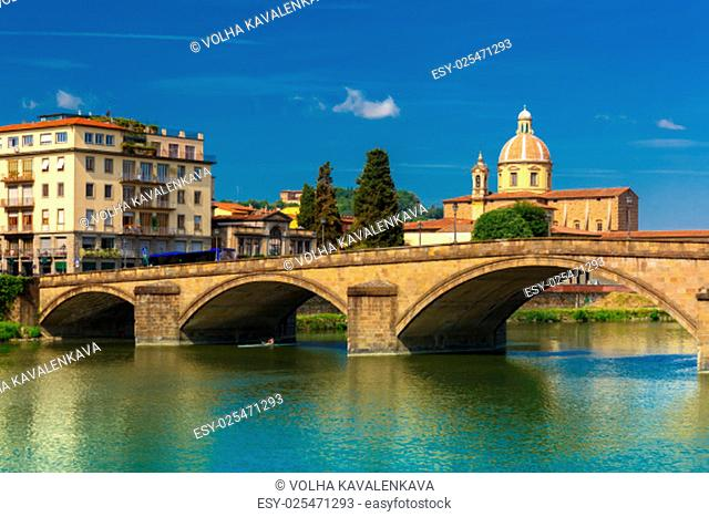 Ponte alla Carraia and Quay of the river Arno in Florence, San Frediano in Cestello on the background, Tuscany, Italy
