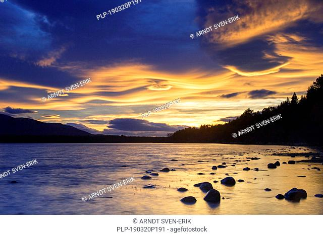 Loch Morlich and Cairngorm Mountains at sunset, Cairngorms National Park near Aviemore, Badenoch and Strathspey, Scotland, UK