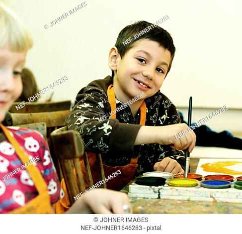 Girl and boy painting pictures