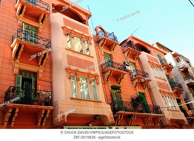 The restored balconies of a group of low-rise apartments feature shuttered doors and wrouhgt iron railings in Beirut's historic center, Lebanon