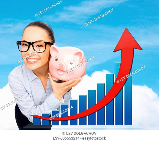 business, banking, finances, investment and people concept - smiling businesswoman in eyeglasses with piggy bank over sky background and growth chart