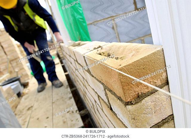 Bricklayer working on housing development