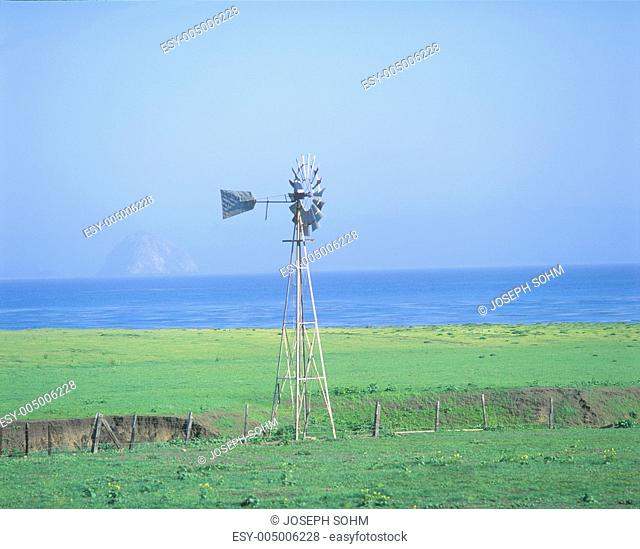 Wooden windmill in a field, Morro Bay, California