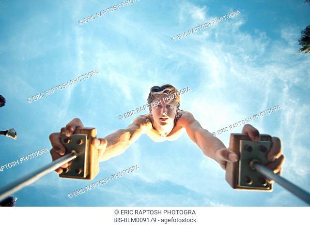 Caucasian man doing handstand