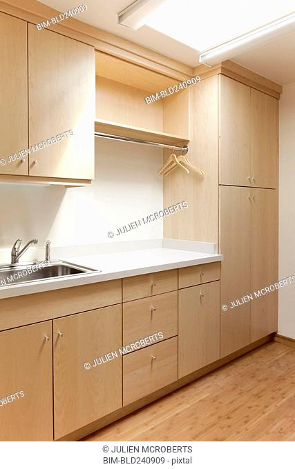 Cabinets and sink in modern room