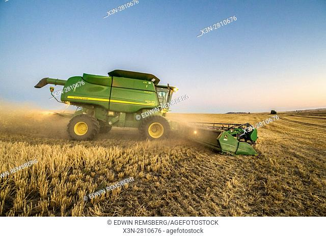 A combine harvester collects and harvests barley grains on a farm in Reardan, Washington