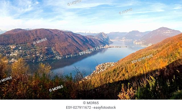 Mont St. Giorgio, Switzerland - November 22, 2014: Images of the Gulf of Lugano city with a gorgeous sunny day in November