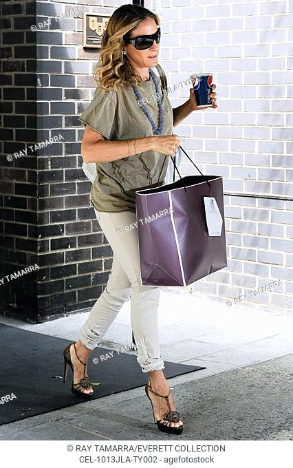 Sarah Jessica Parker, leaves a West Village apartment building out and about for CELEBRITY CANDIDS - TUESDAY, , New York, NY July 13, 2010