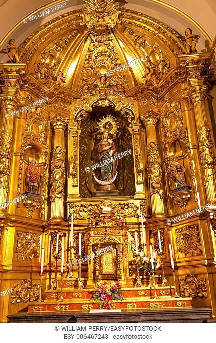Basilica Golden Altar Mary Jesus Statue Santa Iglesia Collegiata de San Isidro Madrid Spain. Named after Patron Saint of Madrid, Saint Isidore