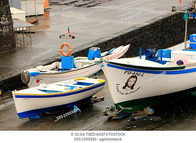 Fishing boats in the seaport of Vilafranca do Campo. Sao Miguel island, Azores, Portugal