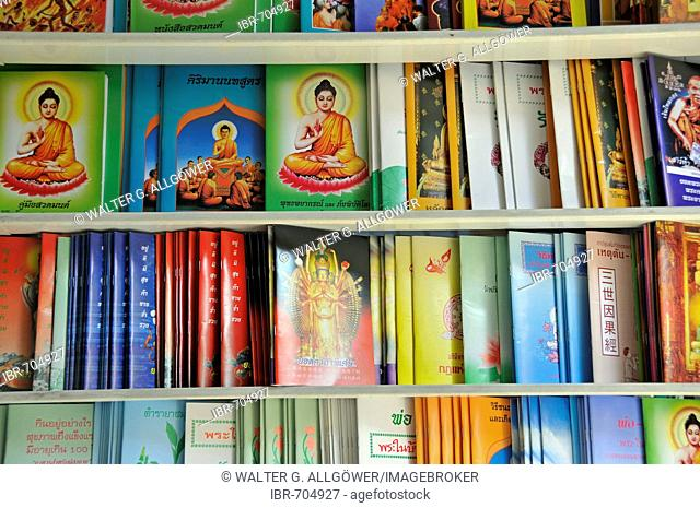 Buddhist literature for sale along Bamrung Muang Road, Bangkok, Thailand, Southeast Asia
