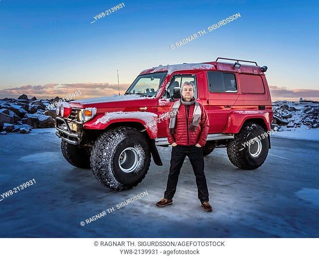 Man in front of a modified Jeep, Iceland