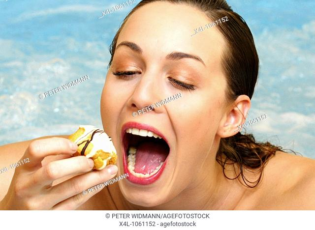 woman relaxing in whirl pool and eating sweets