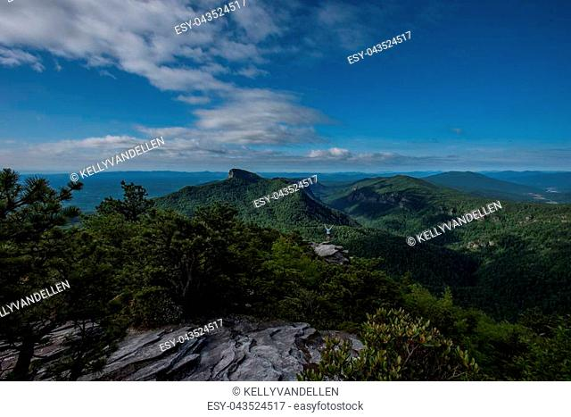 Wide View of Hawksbill Mountain and Linnville Gorge with Woman Power Posing