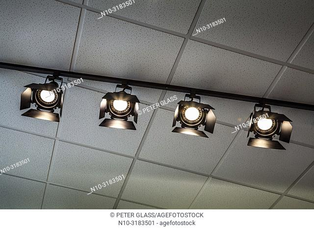 Theatrical lights hanging from the ceiling