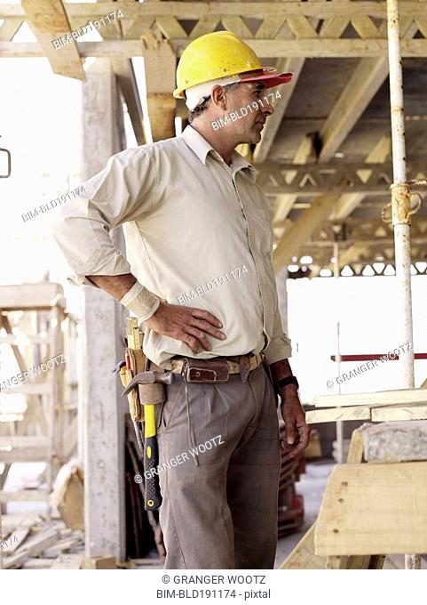 Hispanic worker standing at construction site