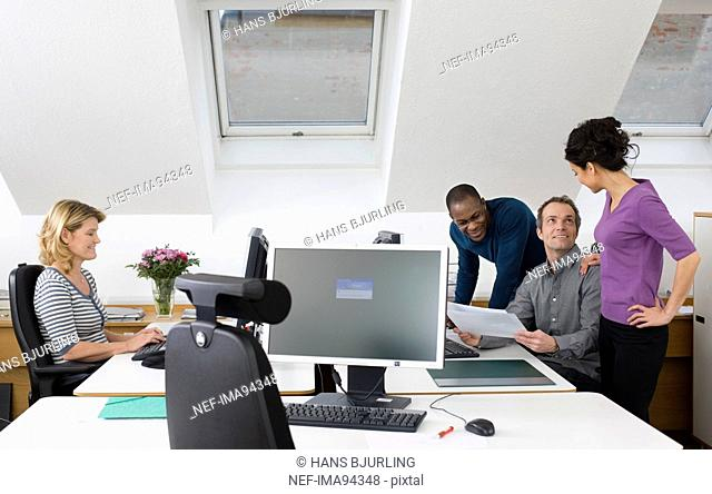 Coworkers together in office