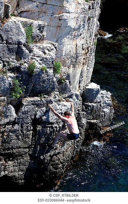 climbing man and sea