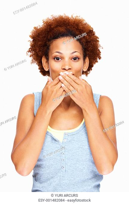 Speak no evil - Pretty lady covering mouth with her hand while over white background