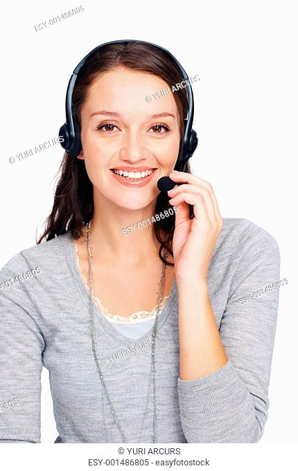 Portrait of beautiful young woman with headset on white background