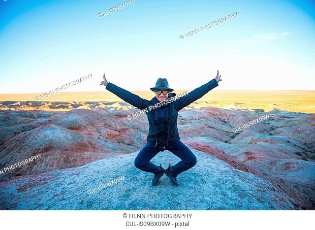 Woman at Bayanzag sandstone cliffs or flaming cliffs, Gobi desert, Mongolia