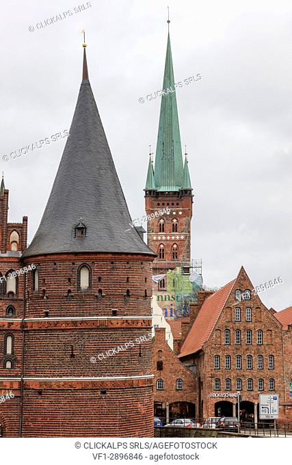 The historical gothic building of Holstentor the city gate for the old town Lübeck Schleswig Holstein Germany Europe