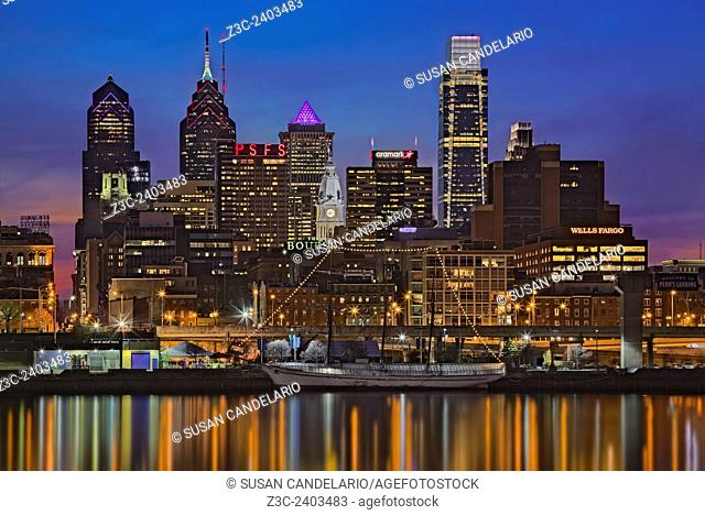 Welcome To Penn's Landing - A view to the Philadelphia Skyline during the blue hour at twilight. The illuminated urban skyline shows the Comcast Building
