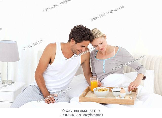 Lovers having breakfast in bed