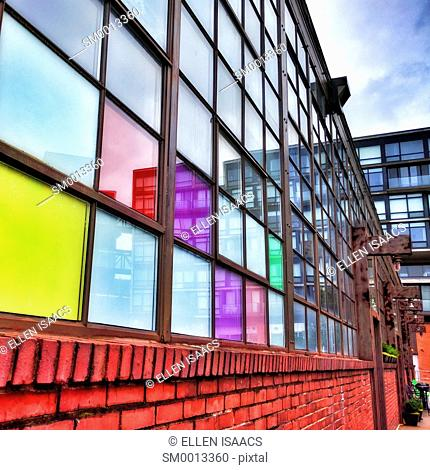 Warehouse with colorful windows converted into apartments in the gentrified Fishtown neighborhood of Philadelphia