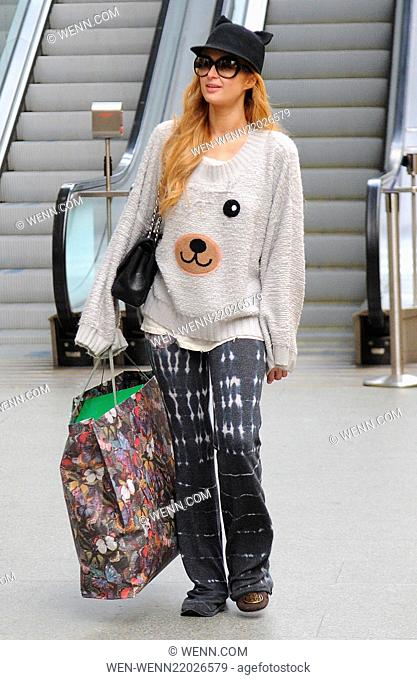 Paris Hilton leaves her London hotel and heads to King's Cross St Pancras International station to catch the Eurostar to Paris Featuring: Paris Hilton Where:...