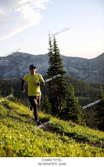Runner on Bloods Lake trail near Guardsman Pass, Wasatch Mountains, Utah, USA