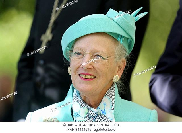 Queen Margrethe II of Denmark sits during a tree planting in Wittenberg, Germany, 02 October 2016. Queen Margrethe II of Denmark brought an altar hanging for...