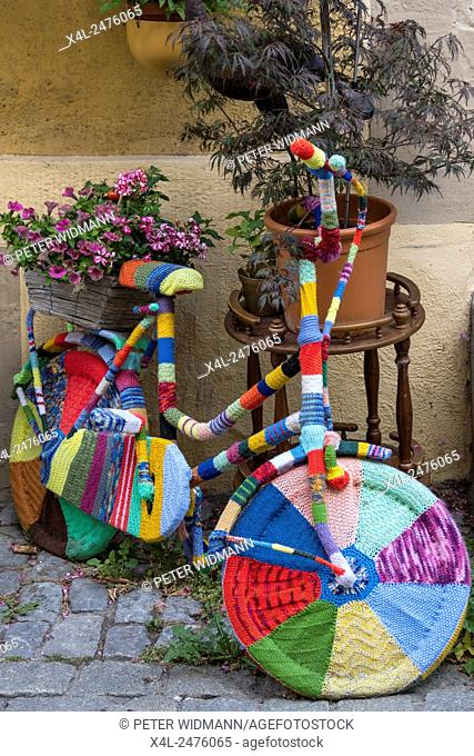 Colorful crocheted covered bike, Rothenburg ob der Tauber, Romantic Road, Middle Franconia, Bavaria, Germany, Europe