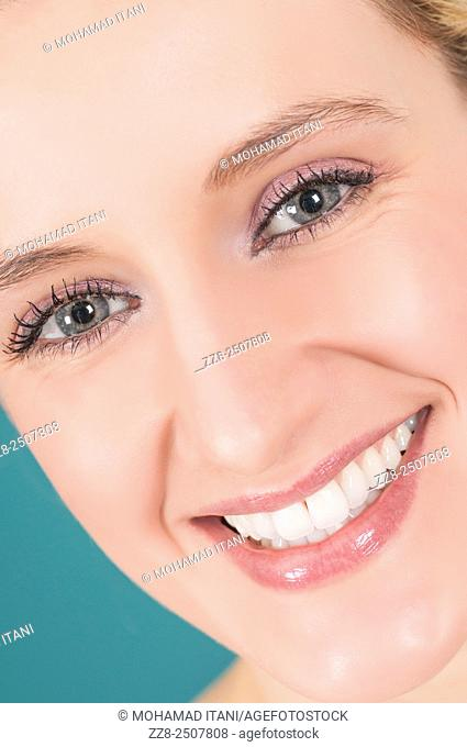 Closeup of a beautiful young woman smiling with healthy white teeth