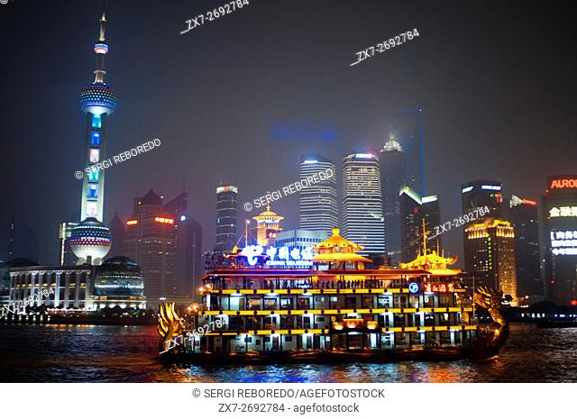 Pudong Skyline by night, Shanghai, China. Skyline of Pudong as seen from the Bund, with landmark Oriental Pearl tower and Jin Mao tower, Shanghai, China