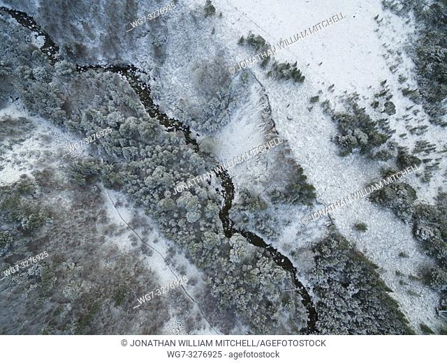 AVIEMORE, SCOTLAND, UK - Jan 17, 2019: Aerial snowy landscape showing nadir view the snowy mountains of the Cairngorms near Aviemore Scotland UK